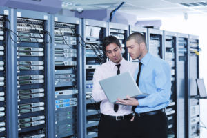 IT professionals in network server room