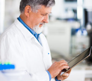 doctor using tablet computer at work